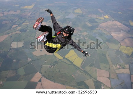 Skydiver falls through the air - stock photo