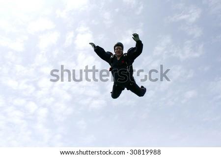 Skydiver falls towards cameraman - stock photo