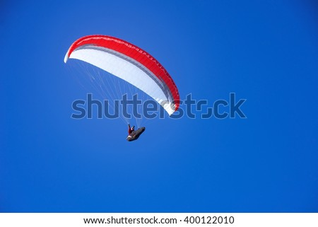 Skydiver flies in the sky - stock photo