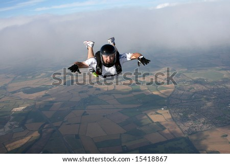 Skydiver in freefall - stock photo
