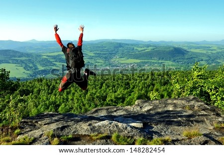 skydiver jumps from the hill - stock photo