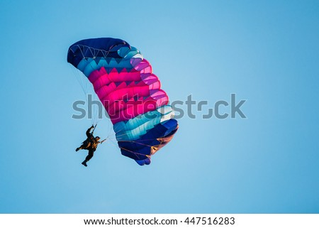 Skydiver On Colorful Parachute In Blue Clear Sky. Active Lifestyle, Extreme Hobbies