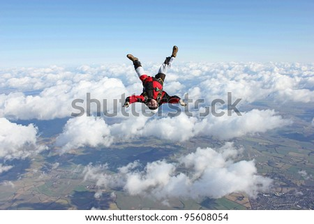 Skydivers flies head down - stock photo