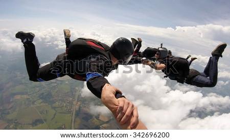 Skydiving friends having fun - stock photo