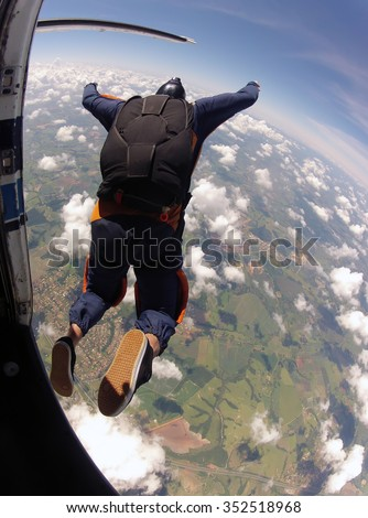 Skydiving jump from the plane vertical photo