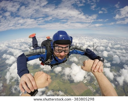 Skydiving men together - stock photo