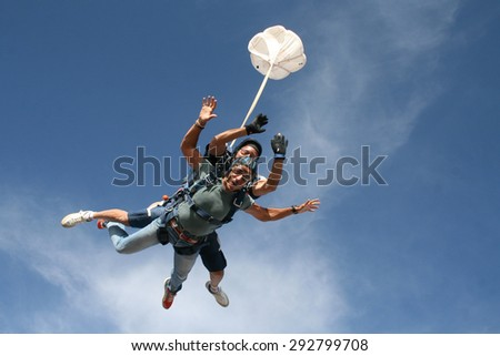 Skydiving tandem - stock photo