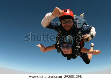 Skydiving tandem happiness - stock photo