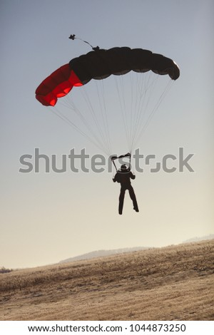 Skyer with a parachute canopy lands on the field. Parachute jumps. Skying. & Parachute Canopy Stock Images Royalty-Free Images u0026 Vectors ...