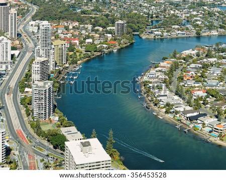 Skyline along Nerang river of Surfers Paradise, Gold Coast. It is one of Australia's iconic coastal tourist destinations. - stock photo