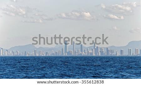 Skyline and a beach of Surfers Paradise, Gold Coast. It one of Australia's iconic coastal tourist destinations. - stock photo