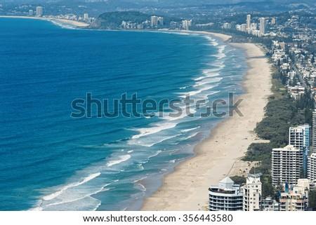 Skyline and beach of Surfers Paradise, Gold Coast. It one of Australia's iconic coastal tourist destinations. - stock photo