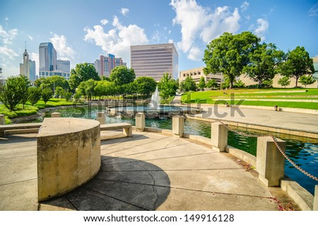 skyline and city streets of charlotte north carolina usa - stock photo