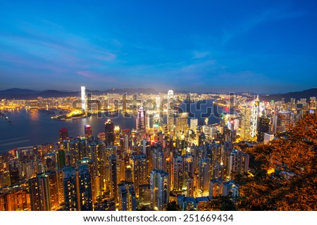 skyline and cityscape of modern city hongkong at night - stock photo