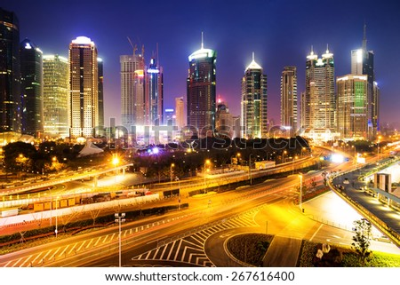 skyline and illuminated cityscape of shanghai at night - stock photo