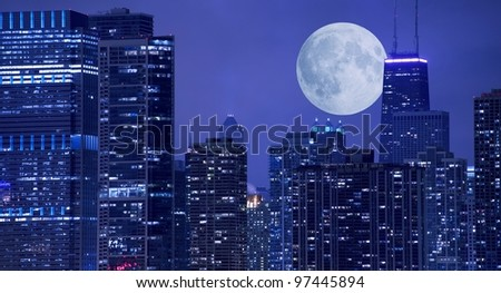 Skyline and Large Moon on the Horizon. Downtown Chicago with Hancock Tower on the Right Side. Panoramic Chicago Skyline. - stock photo