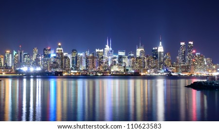 Skyline and modern office buildings of Midtown Manhattan viewed from across the Hudson River.