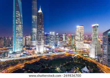 skyline,illuminated skyscrapers in modern city at night. - stock photo