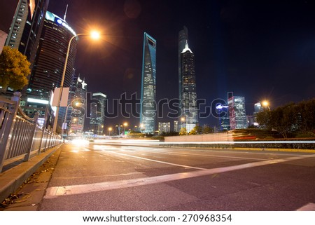 skyline,illuminated skyscrapers in modern city at night.