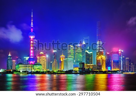 Skyline night  view from Bund waterfront on Pudong New Area- the business quarter of the Shanghai. - stock photo