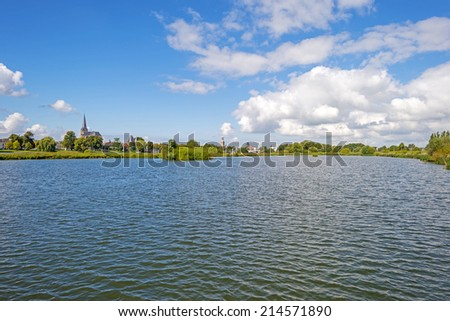 Skyline of an ancient city along a river - stock photo
