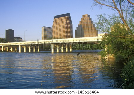 Skyline of Austin, TX, state capitol with Colorado River in foreground - stock photo