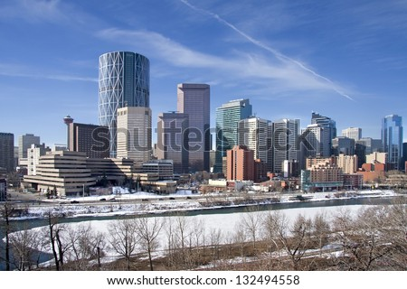 Skyline of Calgary, Alberta, Canada  Bow River partly covered with Snow and Ice. Picture taken March 8, 2013 - stock photo