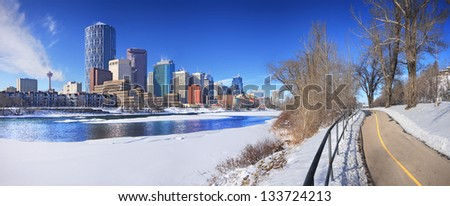 Skyline of Calgary, Alberta, Canada. Bow River partly covered with Snow and Ice. Picture taken March 8, 2013