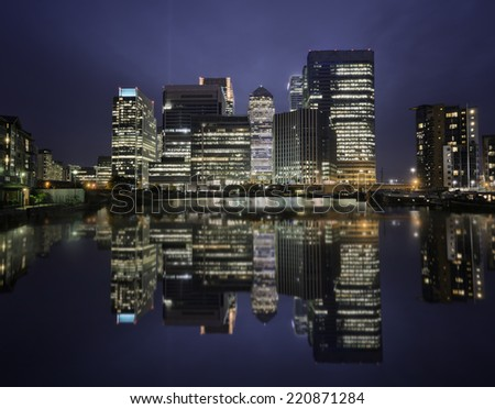 Skyline of Canary Wharf district at night, London, united Kingdom - stock photo