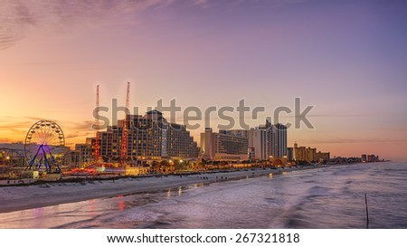 Skyline of Daytona Beach, Florida, at sunset from the fishing pier. Hdr processed. - stock photo