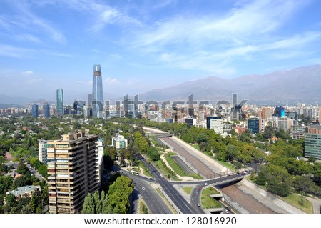 Skyline of downtown Santiago, the capital of Chile, featuring 300-meter high Gran Torre Santiago, the tallest skyscraper in Latin America, and Mapocho River, which divides the city in two parts. - stock photo
