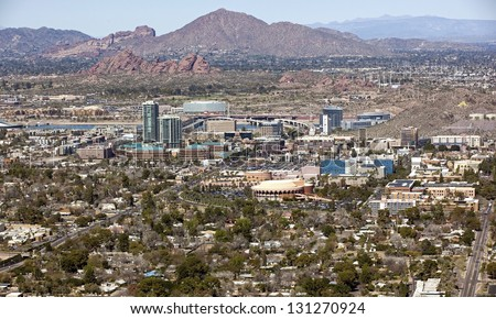 Skyline of downtown Tempe, Arizona with the Papago Buttes and Camelback Mountain in the distance - stock photo
