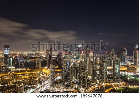 Skyline of Dubai at night - stock photo