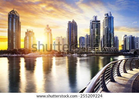 skyline of Dubai Marina at night with boats, United Arab Emirates, Middle East - stock photo