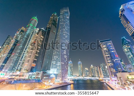 Skyline of Dubai Marina at sunset.