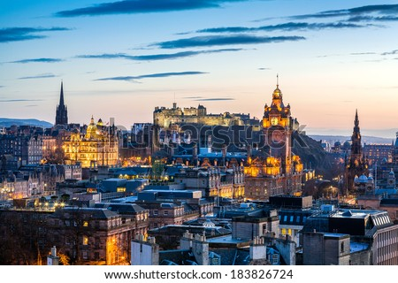 Skyline of Edinburgh at sunset with HDR processing. Cityscape include Edinburgh Castle, Balmoral Hotel Clock Tower and the Scott monument. - stock photo