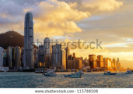 Skyline of Hong Kong at sunset. - stock photo
