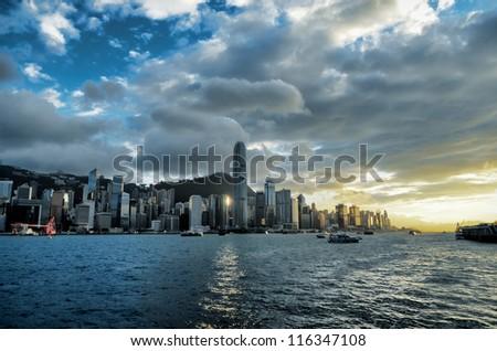 Skyline of Hong Kong at sunset. - stock photo
