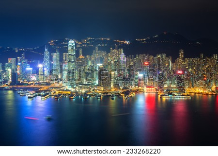 Skyline of Hong Kong at sunset from Sky 100 - stock photo