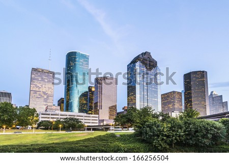 skyline of houston in the evening with bright lights - stock photo
