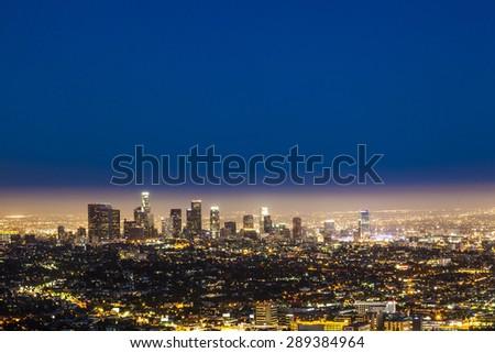 skyline of Los Angeles by night with blue dark sky - stock photo