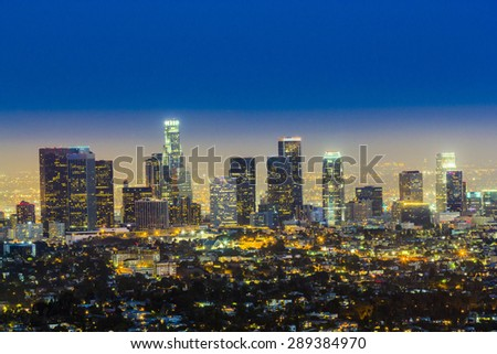 skyline of Los Angeles by night with blue dark sky - stock photo