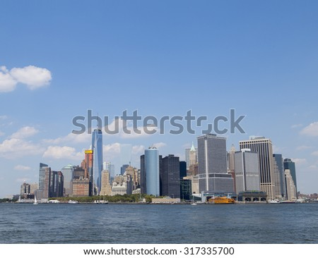 Skyline of lower Manhattan NYC photographed from water. Photographed in Aug 2015. - stock photo