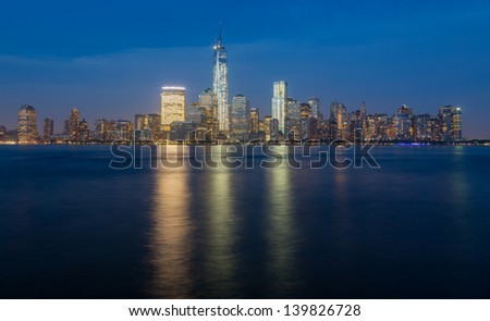 Skyline of lower Manhattan of New York City from Exchange Place at night with World Trade Center at full height of 1776 feet May 2013 - stock photo