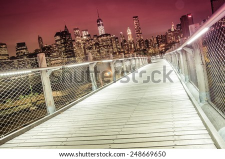 Skyline of Manhattan by night - stock photo