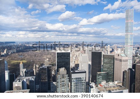 Skyline of Manhattan in New York City, United States. Midtown aerial panorama view with skyscrapers and blue sky in the day