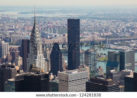 Skyline of Manhattan in New York City, United States, with the Empire State Building and Brooklyn Bridge - stock photo