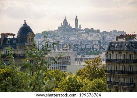 Skyline of Paris. A view from Parc des Buttes Chaumont on Basilica of the Sacre Coeur - stock photo