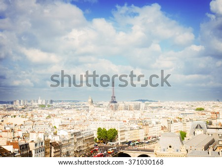 skyline of Paris city roofs with Eiffel Tower from above at summer day, France, retro toned - stock photo
