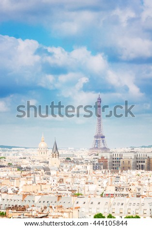 skyline of Paris city roofs with Eiffel Tower from above, France, retro toned - stock photo